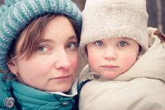 Mom and daughter. On a walk at freeze day Stock Image