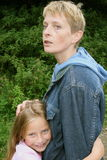 Mom and daughter. Typical she is a bit worried, daughter doesn't care too much Royalty Free Stock Photos