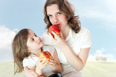 Mom and daughter with apples Stock Image