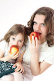 Mom and daughter with apples Stock Images