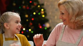 Mom and daughter in aprons giving high five, happy to prepare Christmas dinner. Stock footage stock video