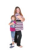 Mom and daughter attitude. Full length portraits of a young woman and her daughter showing attitude over white royalty free stock images