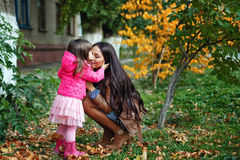Mom with daughter in autumn park Royalty Free Stock Images
