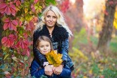 Mom daughter autumn walk Stock Photos