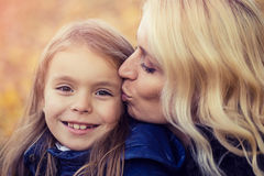 Mom daughter autumn walk Stock Photography