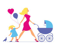 Mom with daughter and baby in baby carriage. Little girl feeds  Stock Photos