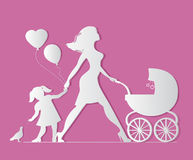 Mom with daughter and baby in carriage. Little girl feeds b Royalty Free Stock Images