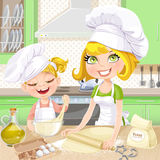 Mom and daughter baking cookies in the kitchen Royalty Free Stock Photos