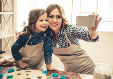 Mom and daughter baking Stock Photos