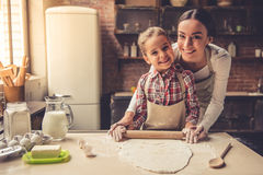 Mom and daughter baking Royalty Free Stock Image