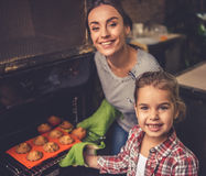 Mom and daughter baking Stock Images