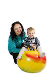 Mom and daughter on the ball for fitness Royalty Free Stock Photo