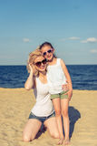 Mom and daughter on the beach Stock Photography