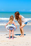 Mom daughter beach fun Stock Photography