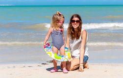Mom daughter beach fun Royalty Free Stock Image