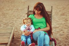 Mom and daughter on the beach royalty free stock images