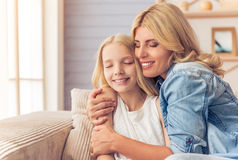 Mom and daughter Stock Images