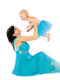Mom and daughter. In a beautiful blue dresses happily spend time together Stock Photos