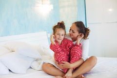 Mom with daughter in the bed Royalty Free Stock Image