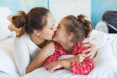 Mom with daughter in the bed Stock Photos