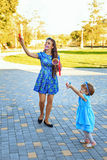 Mom and daughter blow bubbles Royalty Free Stock Images