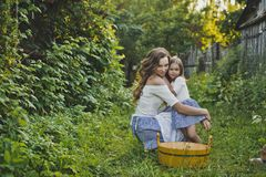 Mom and daughter blowing bubbles outdoors 4712. Mother with daughter blowing bubbles royalty free stock image