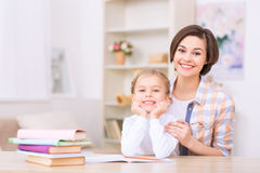 Mom and daughter are both smiling brightly Stock Photo