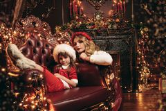 Christmas in house. Mom and daughter celebrate Christmas in beautiful decorated apartments. Time for miracles royalty free stock photos