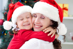 Mom and daughter in Christmas royalty free stock photos