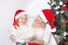 Mom and daughter at Christmas Stock Image