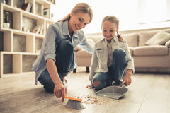 Mom and daughter cleaning Stock Photography
