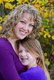 Mom and Daughter. A close-up portrait of a beautiful young mother and her pre-teen daughter wearing braces Stock Photo