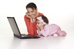 Mom with daughter and computer. Mom and little daughter with laptop on white Stock Photo