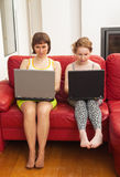 Mom and daughter with computers Royalty Free Stock Photo