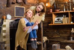 Mom and daughter with concentrated look reading together, home education concept. Beautiful blond ladies amused by. Interesting book. Sisters spending time in Royalty Free Stock Images