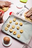 Mom and daughter cook biscuits with dough berries stock images