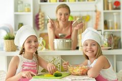 Mom and daughter cook. Portrait of mom and daughter cook to eat Royalty Free Stock Photo