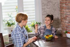 Mom and daughter cook together at home royalty free stock photos