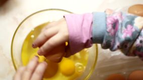 Mom and daughter are cooking scrambled eggs in the kitchen