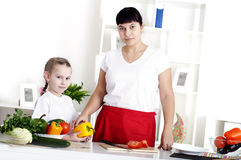 Mom and daughter cooking together Royalty Free Stock Images