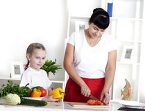 Mom and daughter cooking together Stock Photo