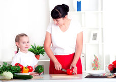 Mom and daughter cooking together Royalty Free Stock Photo
