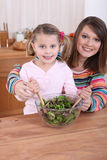 Mom and daughter cooking Stock Image