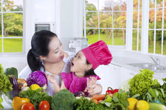 Mom with daughter cooks in the kitchen Royalty Free Stock Photo
