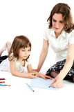 Mom and daughter crayon on paper Royalty Free Stock Images