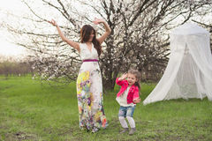 Mom and daughter dancing in nature together Stock Photo