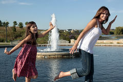 Mom and daughter dancing in park Stock Photo