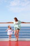 Mom and daughter on deck of yacht Stock Images