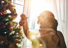 Mom and daughter decorate the Christmas tree Royalty Free Stock Photo