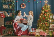 Mom and daughter decorate the tree Stock Images